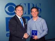 Matt Broderick (right) President of DiagnosTemps receives a True Blue plaque from Scott Sams